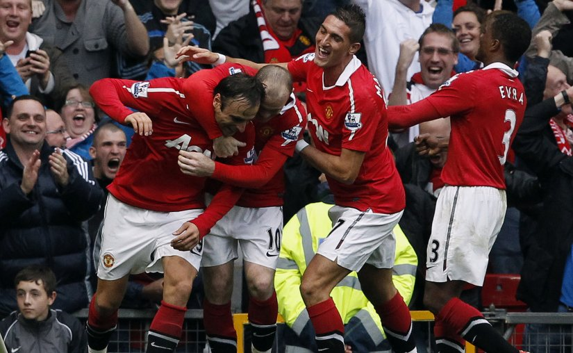 Manchester United's Dimitar Berbatov celebrates with teammates after scoring his third goal against Liverpool. Reuters