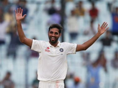 Bhuvneshwar Kumar celebrates after dismissing New Zealand's Matt Henry. AP