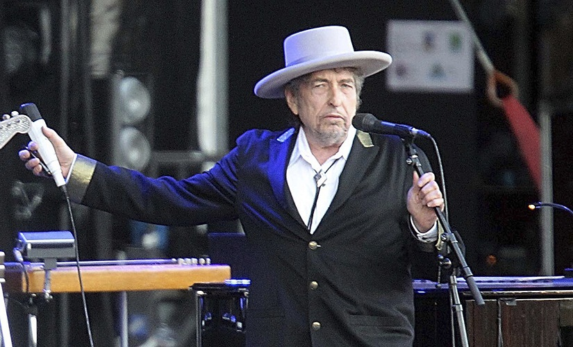 """FILE - This July 22, 2012, file photo shows U.S. singer-songwriter Bob Dylan performing onstage at """"Les Vieilles Charrues"""" Festival in Carhaix, western France. Dylan won the 2016 Nobel Prize in literature, announced Thursday, Oct. 13, 2016. (AP Photo/David Vincent, File)"""