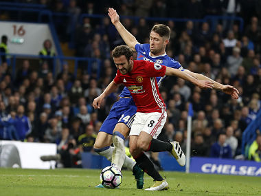 Chelsea's Gary Cahill and Manchester United''s Juan Mata challenge for the ball during the English Premier League clash. AP