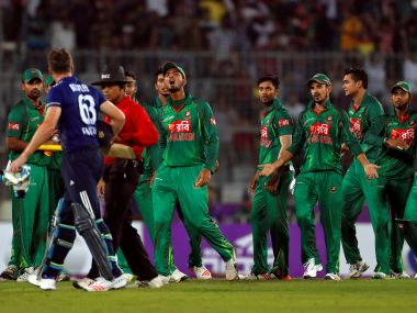 Bangladesh players exchange words with Jos Buttler after his dismissal. Reuters