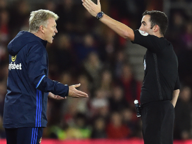 David Moyes (L) was sent off by referee Chris Kavanagh after his touchline misconduct. AFP