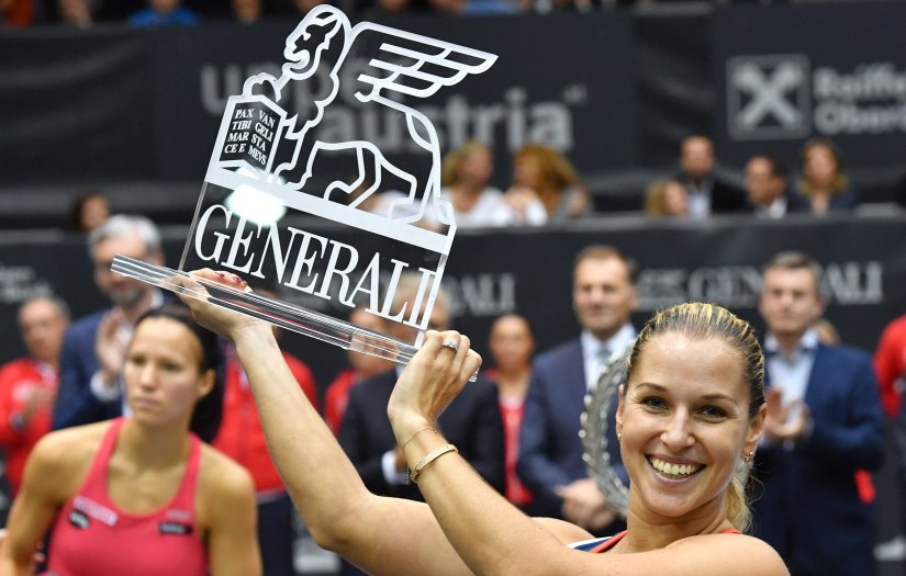 Dominika Cibulkova poses with her trophy after her final match against Viktorija Golubic. AP