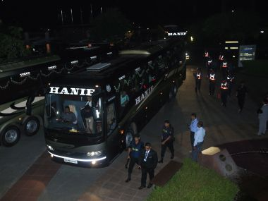 Bangladeshi security officers escort a bus carrying the England players. AFP