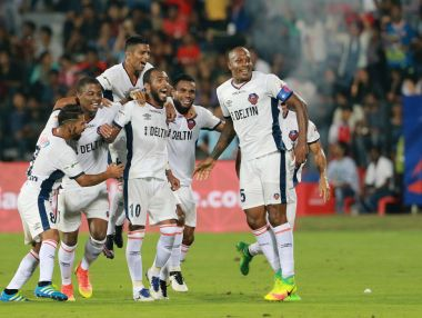 FC Goa players celebrate scoring against Mumbai City FC. ISL