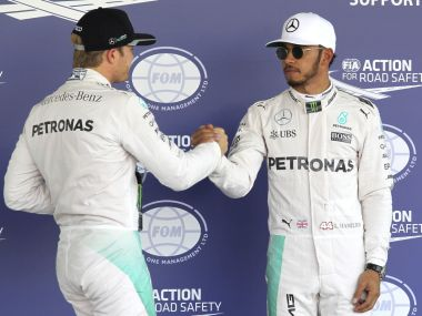Lewis Hamilton and Nico Rosberg shake hands after Mercedes clinch a 1-2 on the grid ahead of the Mexican GP. AP