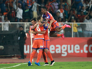FC Pune City players celebrate a goal. ISL
