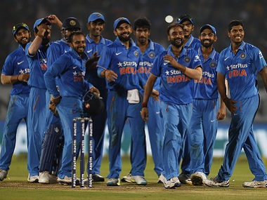 Indian players celebrate with teammates after taking a New Zealand wicket. AP