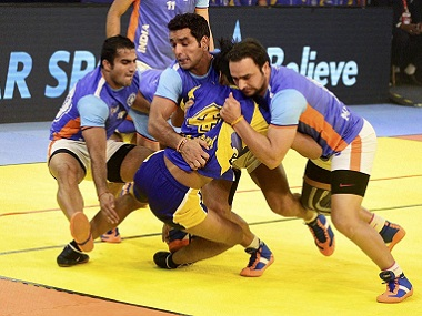 Indian kabaddi players try to catch their Thai counterpart. PTI