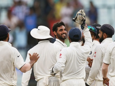 Indian bowlers and fielders celebrate after a wicket. AP