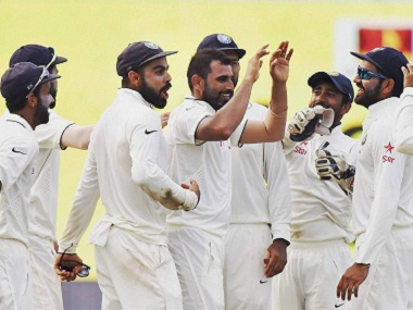India's bowlers and fielders celebrate the fall of a wicket. PTI