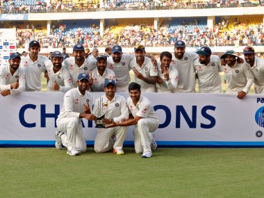 India's players with the trophy after winning the Test series against New Zealand. Reuters