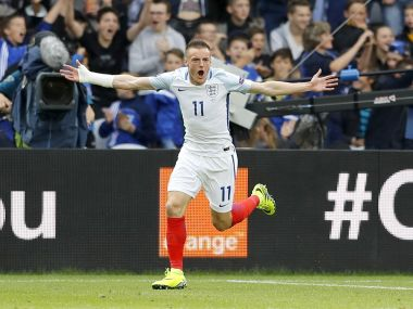 England's Jamie Vardy celebrates after scoring his side's first goal during the Euro 2016 Group B soccer match between England and Wales at the Bollaert stadium in Lens, France, Thursday, June 16, 2016. (AP Photo/Frank Augstein)