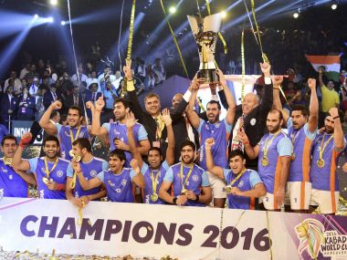 Indian players celebrate with the winning trophy. PTI