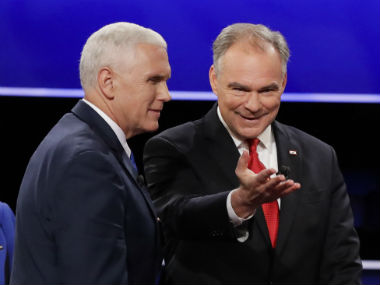 Mike Pence (left) with Tim Kaine. AP