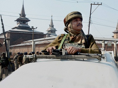 Srinagar: A Security jawan stands guard atop a vehicle during the 105th day of curfew and restrictions imposed to prevent post-Friday prayer protests in Srinagar on Friday. PTI Photo (PTI10_21_2016_000137B)