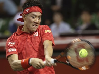 Kei Nishikori in action against Donald Young at the Japan Open. AP