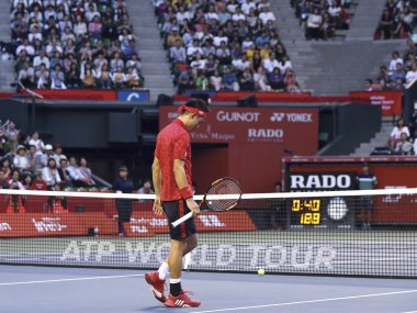 Kei Nishikori walks on the center court as he retires from his match against Joao Sousa. AP