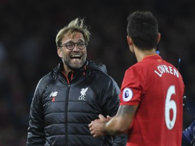 Liverpool manager Jurgen Klopp with defender Dejan Lovren. AFP