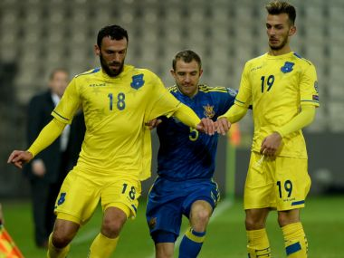 Kosovo players vie for the ball against Ukraine. AFP