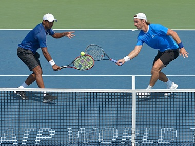 WINSTON SALEM, NC - AUGUST 27: Leander Paes of India, left, Andre Begemann of Germany return a shot to Guillermo Garcia-Lopez of Spain and Henri Kontinen of Finland in the men's doubles championship final of the Winston-Salem Open at Wake Forest University on August 27, 2016 in Winston Salem, North Carolina. (Photo by Grant Halverson/Getty Images)