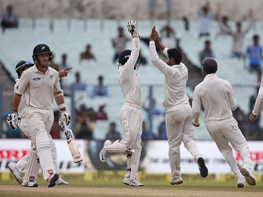 Indian players celebrate the wicket of New Zealand's Luke Ronchi. AP