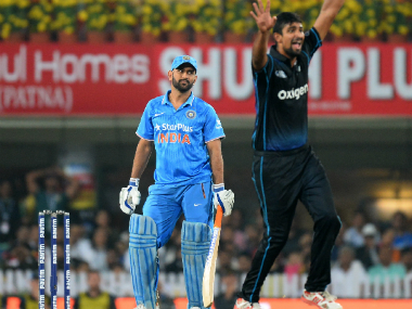 MS Dhoni (L) couldn't see India through to victory. AFP