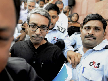 JNU V-C M Jagadesh Kumar coming out of office after being gheraoed by students. PTI