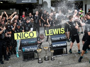 Mercedes' Nico Rosberg and Lewis Hamilton celebrate after they won the Constructors' Championship. Reuters