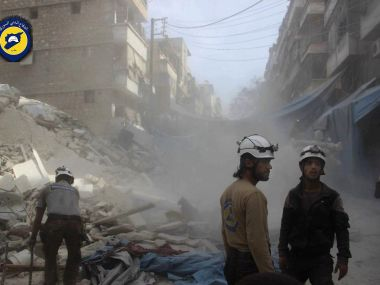 Syrian Civil Defense workers search through the rubble in rebel-held eastern Aleppo. Syrian Civil Defense-White Helmets via AP