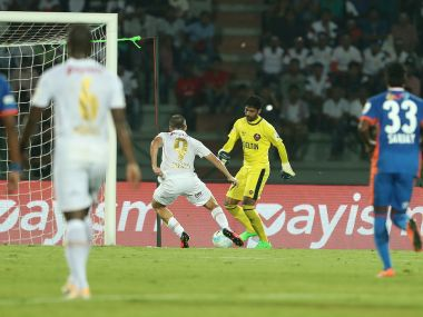 Emiliano Alfaro of NorthEast United FC takes the ball off the FC Goa keeper to score. ISL
