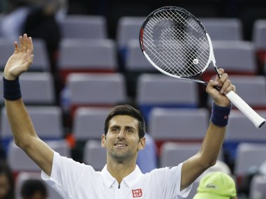 Novak Djokovic celebrates after defeating Vasek Pospisil. AP