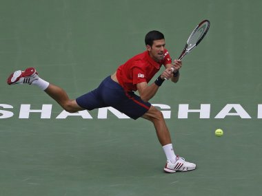 Novak Djokovic hits a return shot against Misha Zverev. AP