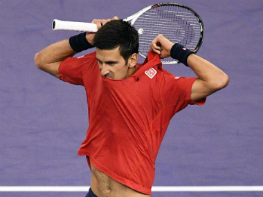 Djokovic smashed his racquet, tore his shirt and fumed at the umpire during his loss. AFP