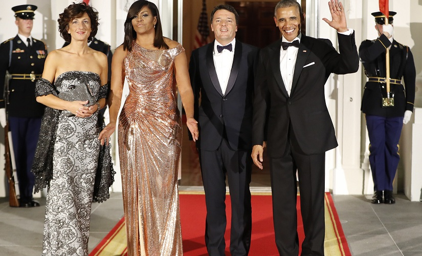President Barack Obama and first lady Michelle Obama pose for a photo as they greet Italian Prime Minister Matteo Renzi and his wife Agnese Landini on the North Portico for a State Dinner at the White House in Washington, Tuesday, Oct. 18, 2016. (AP Photo/Pablo Martinez Monsivais)