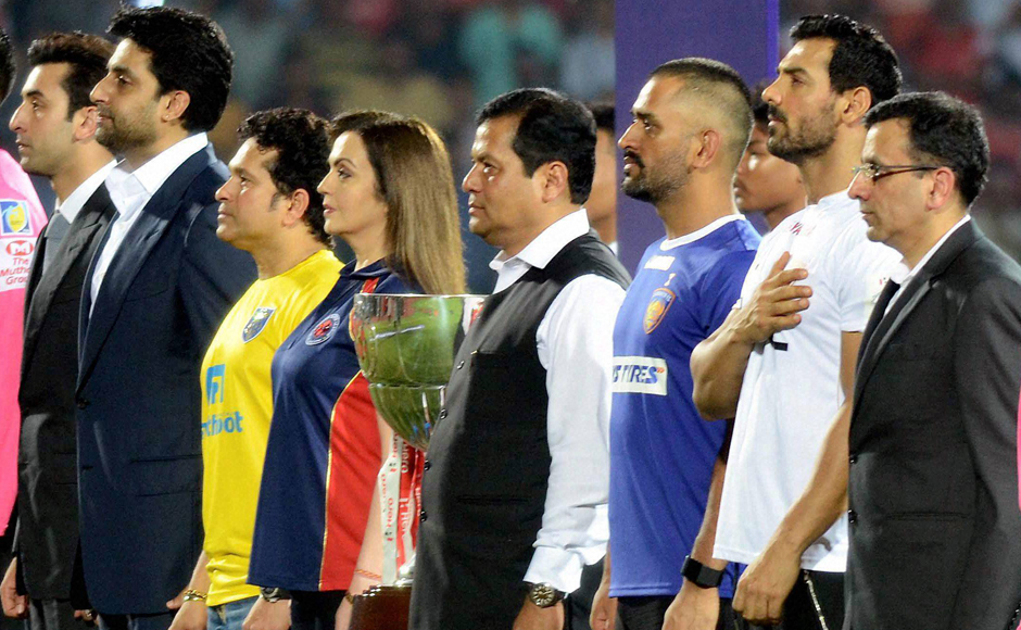 Nita Ambani, Founder and Chairperson of ISL, Assam Chief Minister, Sarbananda Sonowal, Chennaiyin FC co-owners Mahendra Singh Dhoni and Abhishek Bachchan, Kerala Blasters FC co-owner Sachin Tendulkar, and Mumbai City FC co-owner, Ranbir Kapoor during the opening ceremony of 3rd season of Indian Super League in Guwahati. PTI