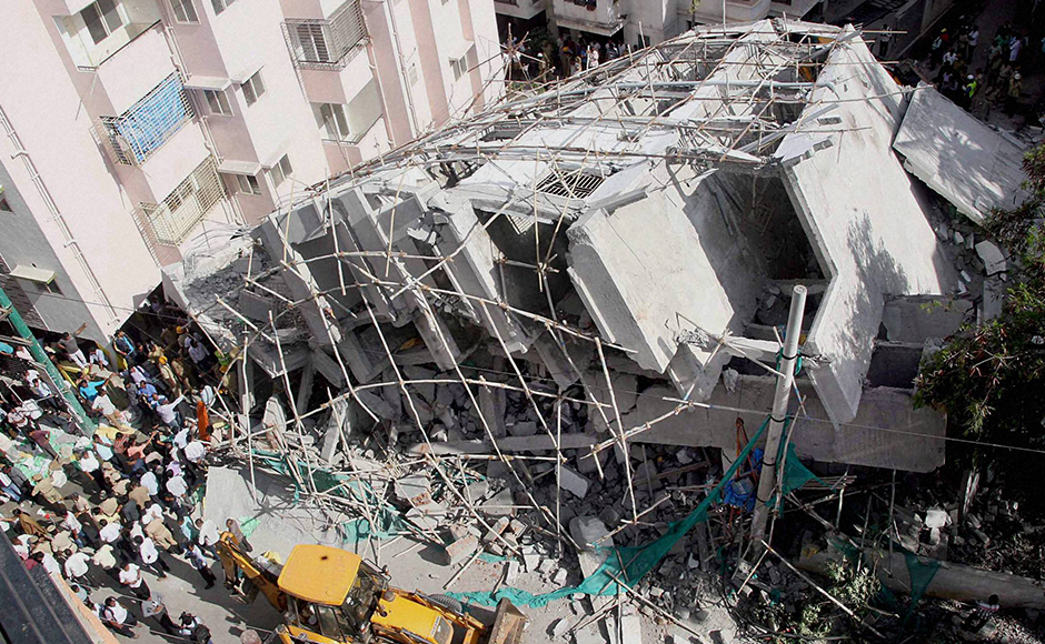 One person was killed and four others are feared trapped under the rubble after a seven-storey under-construction building collapsed. Photo: PTI