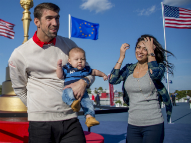 File image of Michael Phelps, Nicole Johnson and their son Boomer. AFP