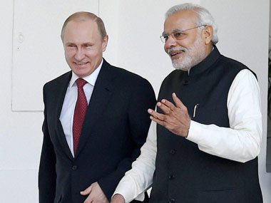 A file photo of Vladimir Putin, PM Modi. PTI