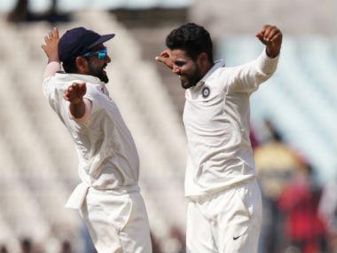 Ravindra Jadeja celebrates a dismissal with team-mate Rohit Sharma. AP