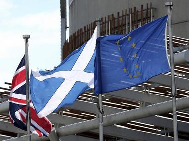 Union, Scottish Soltaire and European Union flags (L-R) fly outside of Scottish Parliament building in Edinburgh, Scotland, Britain, July 1, 2016. Reuters