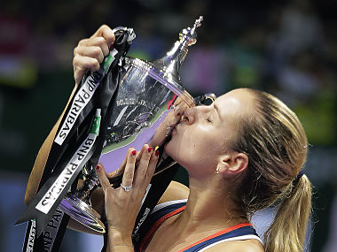 Dominika Cibulkova of Slovakia kisses her trophy after beating Angelique Kerber of Germany in their women's singles final match at the WTA tournament in Singapore. AP