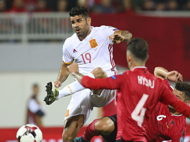 Albania's Elseid Hysaj fight for the ball with Spain's Diego Costa during their World Cup Group G match. AP