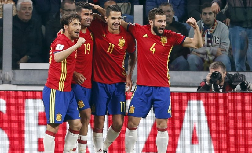 Spain players celebrate after scoring during World Cup qualifying match against Italy. AP