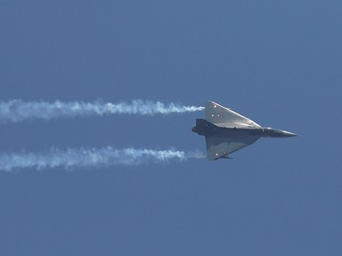 """An Indian Air Force (IAF) light combat aircraft """"Tejas"""" performs during the Indian Air Force Day celebrations at the Hindon Air Force Station on the outskirts of New Delhi on 8 October. Reuters"""