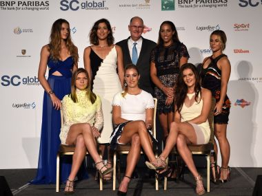 Women's Tennis Association CEO Steve Simon poses with the WTA Finals qualifiers. AFP