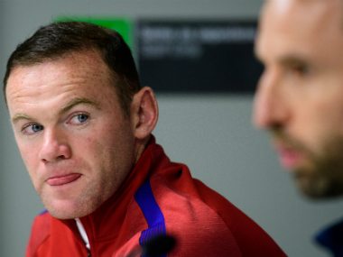 Bryan Robson believes Wayne Rooney's recent England performances have been undeservedly booed. AFP