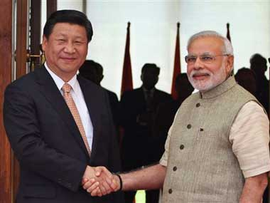 Chinese President Xi Jinping with Prime Minister Narendra Modi. AP