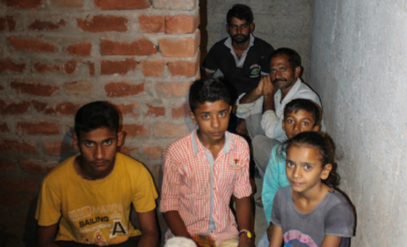 Naresh Kumar, with his family members inside the underground inside their house. Firstpost/Sameer Yasir