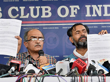 "Prashant Bhushan and Yogendra Yadav landed at the Press Club in New Delhi on Thursday to make an ""explosive exposé"" against Varun Gandhi. PTI"